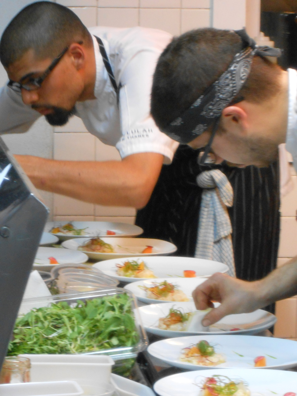 "Chefs prepare scallop ""crudo""with big black dog farm radish, pickled persimmon, yuzu, fennel"