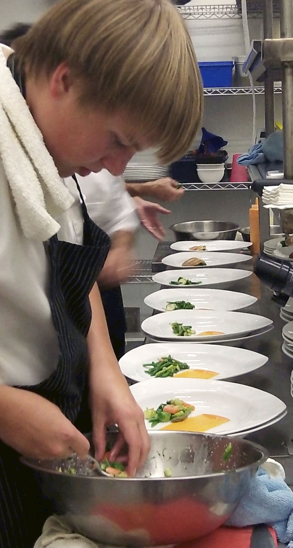 Chefs prepare redfish dish