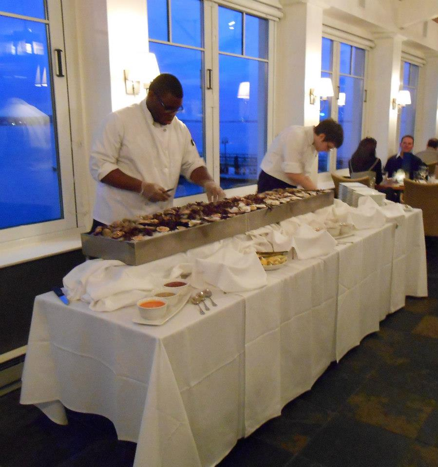 Chefs prepare the raw bar.