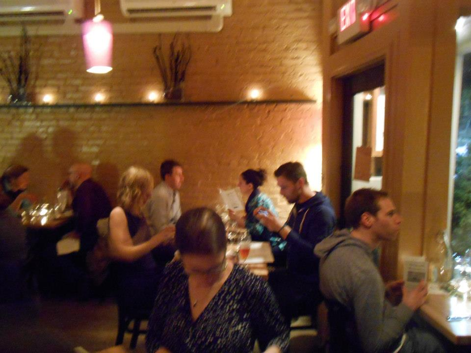 Guests enjoy their cocktails and preview the menu to come.