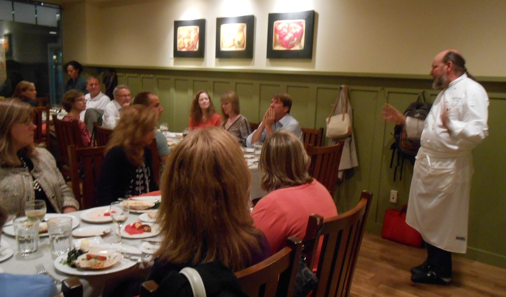 Chef Peter Davis engages in dialogue with the guests about the importance of knowing where your food comes from.