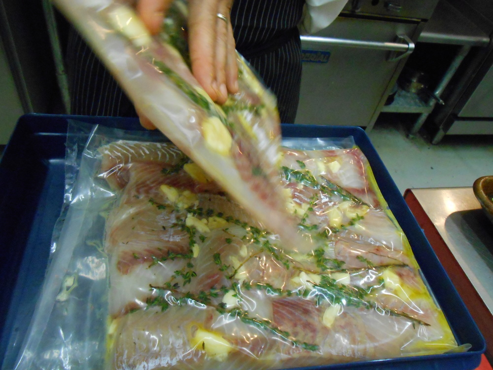 Pollock was prepared sous vide -- cooked in a warm water bath in a vac-pack bag with herbs