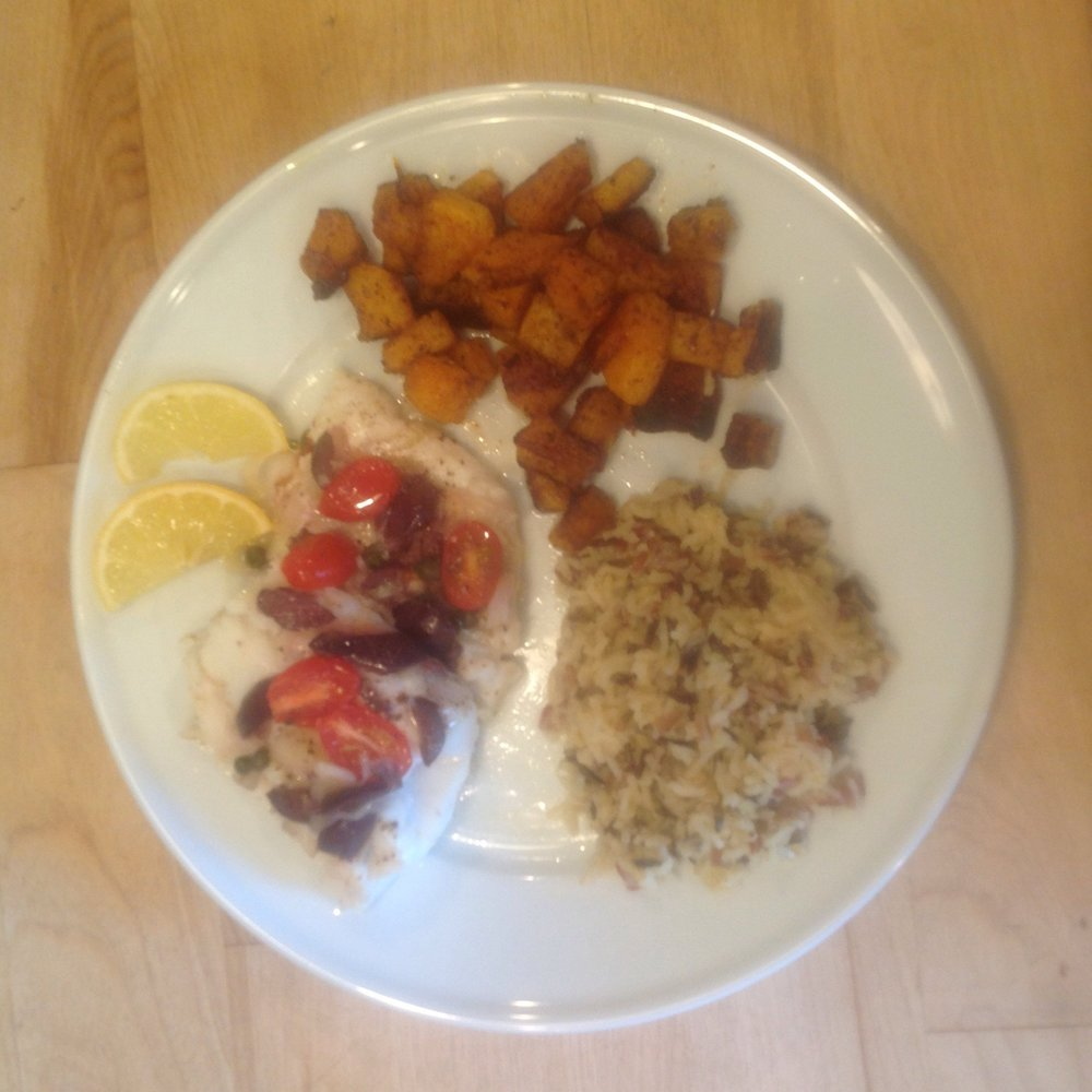 Mediteranian-style baked cod with roasted squash and wild rice