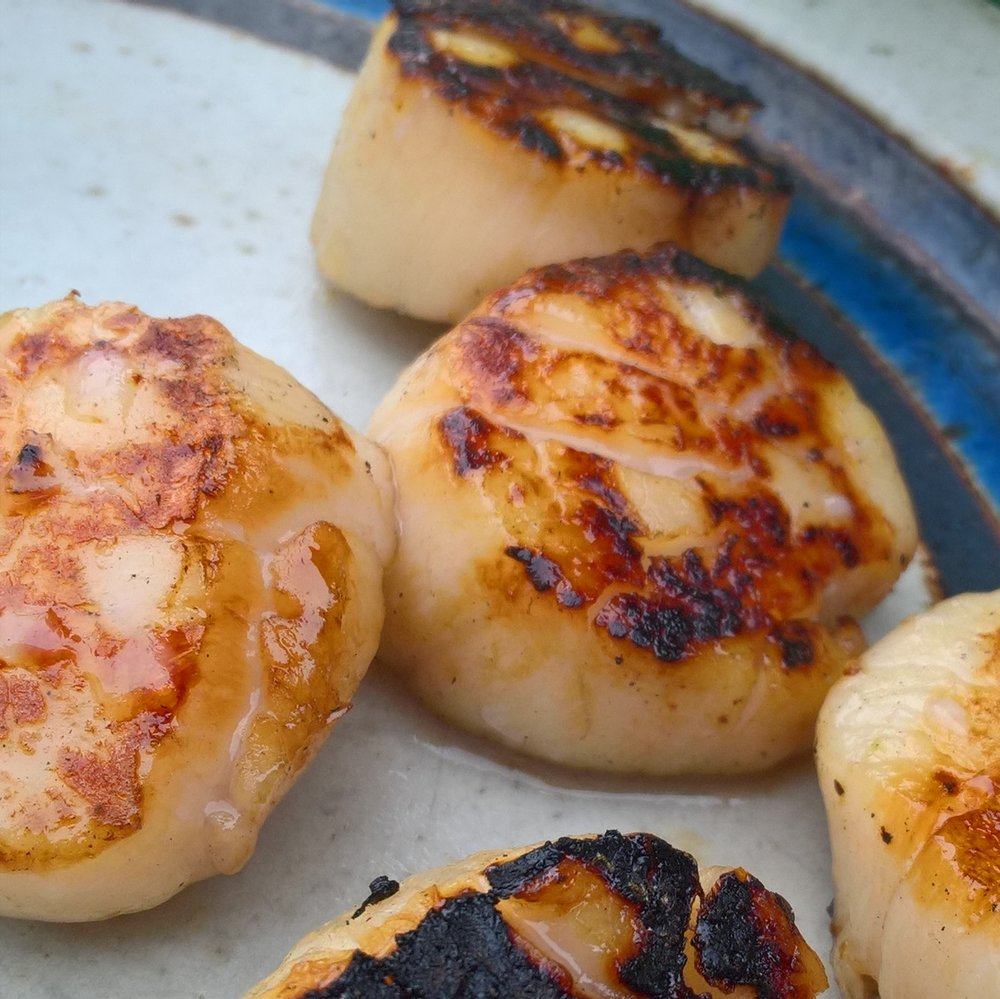 Grilled sea scallops with brown sugar and bourbon glaze.