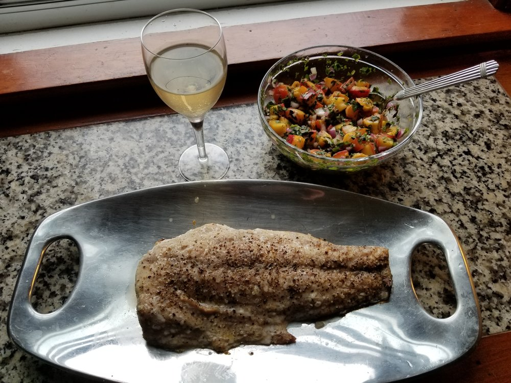 Roasted sea bass with grilled peach salsa