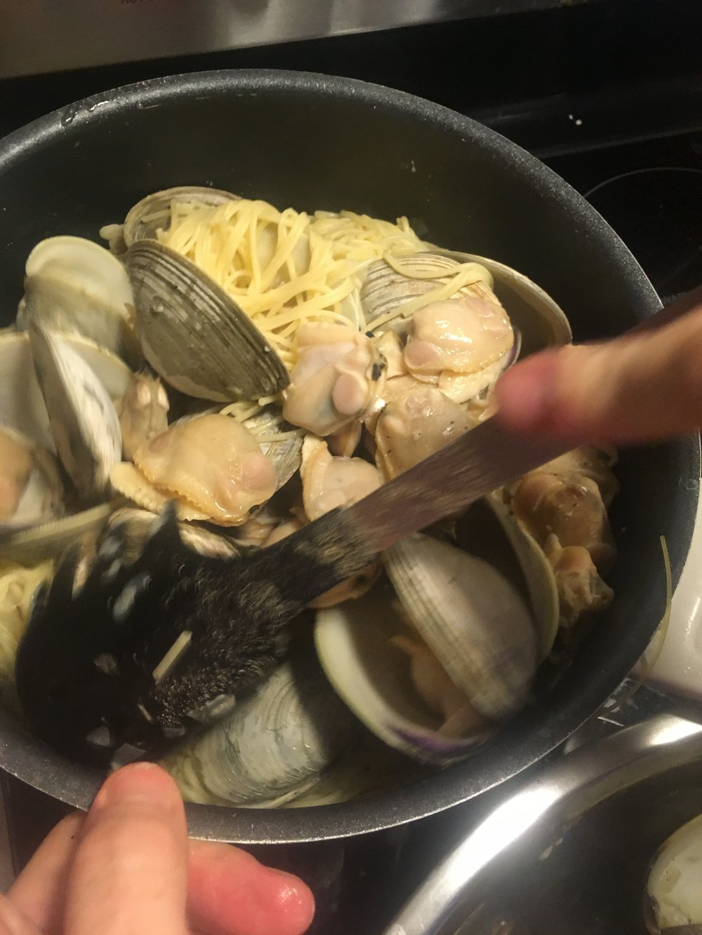 Clams and linguine with sausage