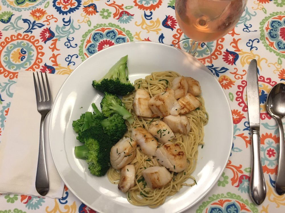 "Seared ""scallop pieces"" with lemon butter wine sauce, served with pasta and steamed broccoli"
