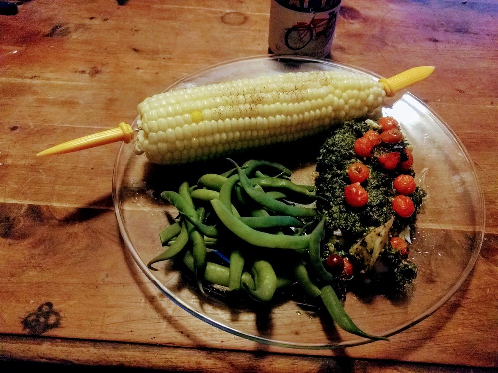 Baked Pollock with garden pesto, steamed garden green beans, and farmer's market corn