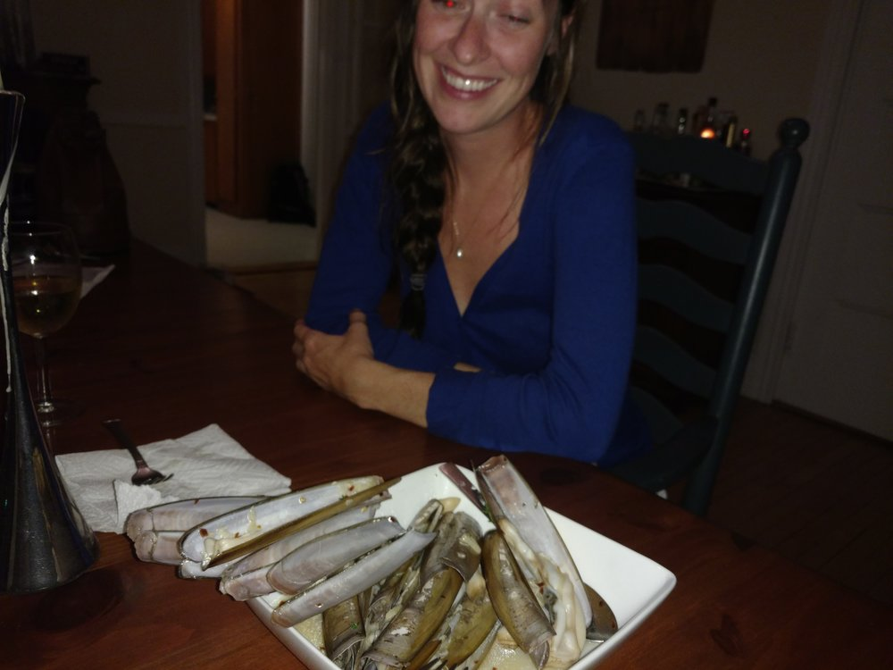 Devon, enjoying razor clams after an Old Crow concert on the Portland waterfront. What a night!