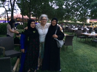 Leora Kahn, PROOF's Executive DIrector, with conference delegates- and new friends
