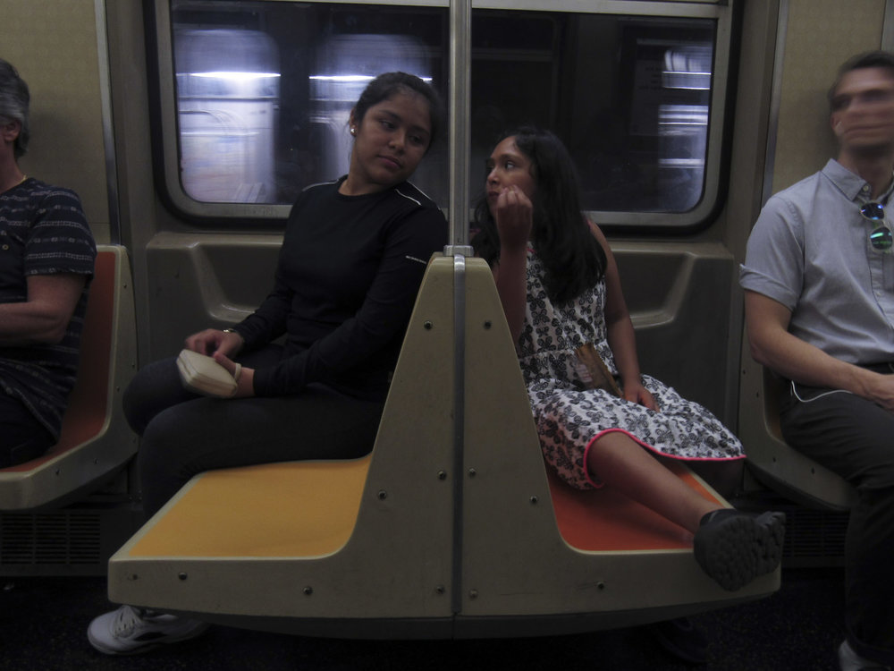 Heidi and her younger sister, Michelle, were separated from their mother for three years before the New York Sanctuary Coalition advocated for her release through protests and campaigns across the country. The two sisters, born in the United States, ride the subway beneath their native city, New York. New York City, New York – August 17, 2017
