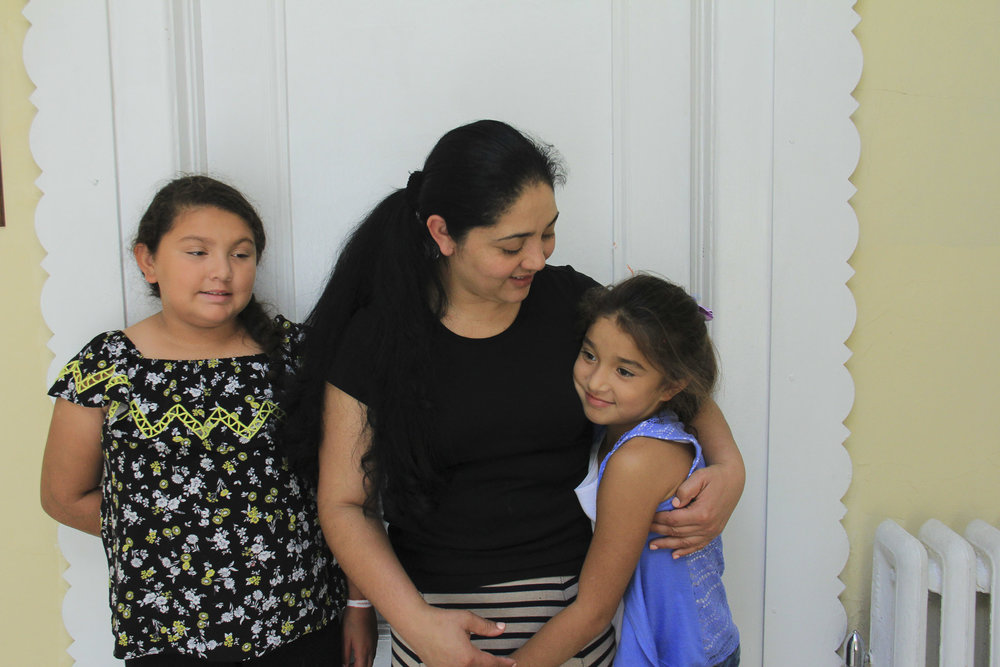 Amanda with two of her children. Holyrood Episcopal Church in Washington Heights, New York. August 17, 2017.