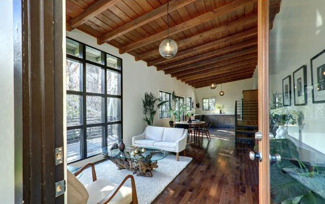 This is a true post & beam with loads of exposed wood and ample light-filled rooms.