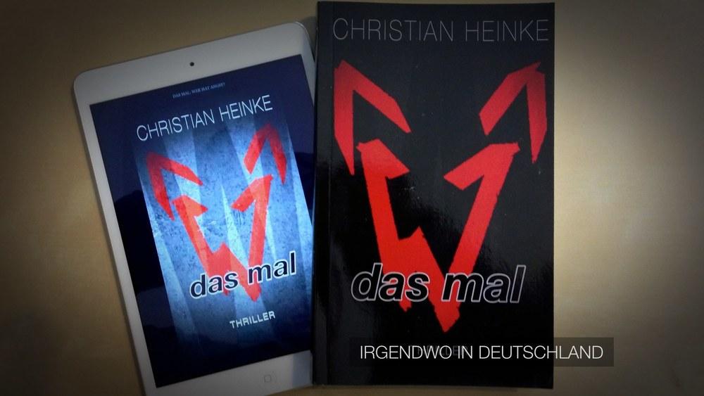 »Das Mal« als eBook auf dem iPad mini (Links) und als Taschenbuch (Rechts)