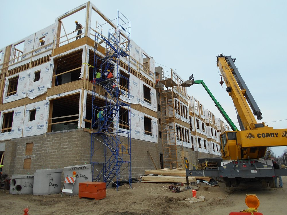 8 Stud walls going up (4th story).JPG