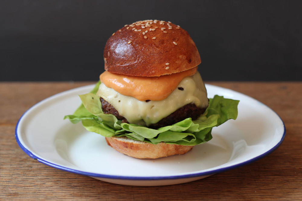 Sous vide chuck and marrow burgers on brioche buns with special sauce ...
