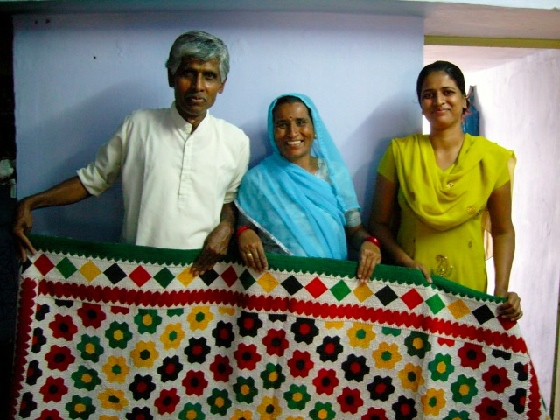 Master quilt-makers, Rhymill and wife and daughter, with one of their quilt designs