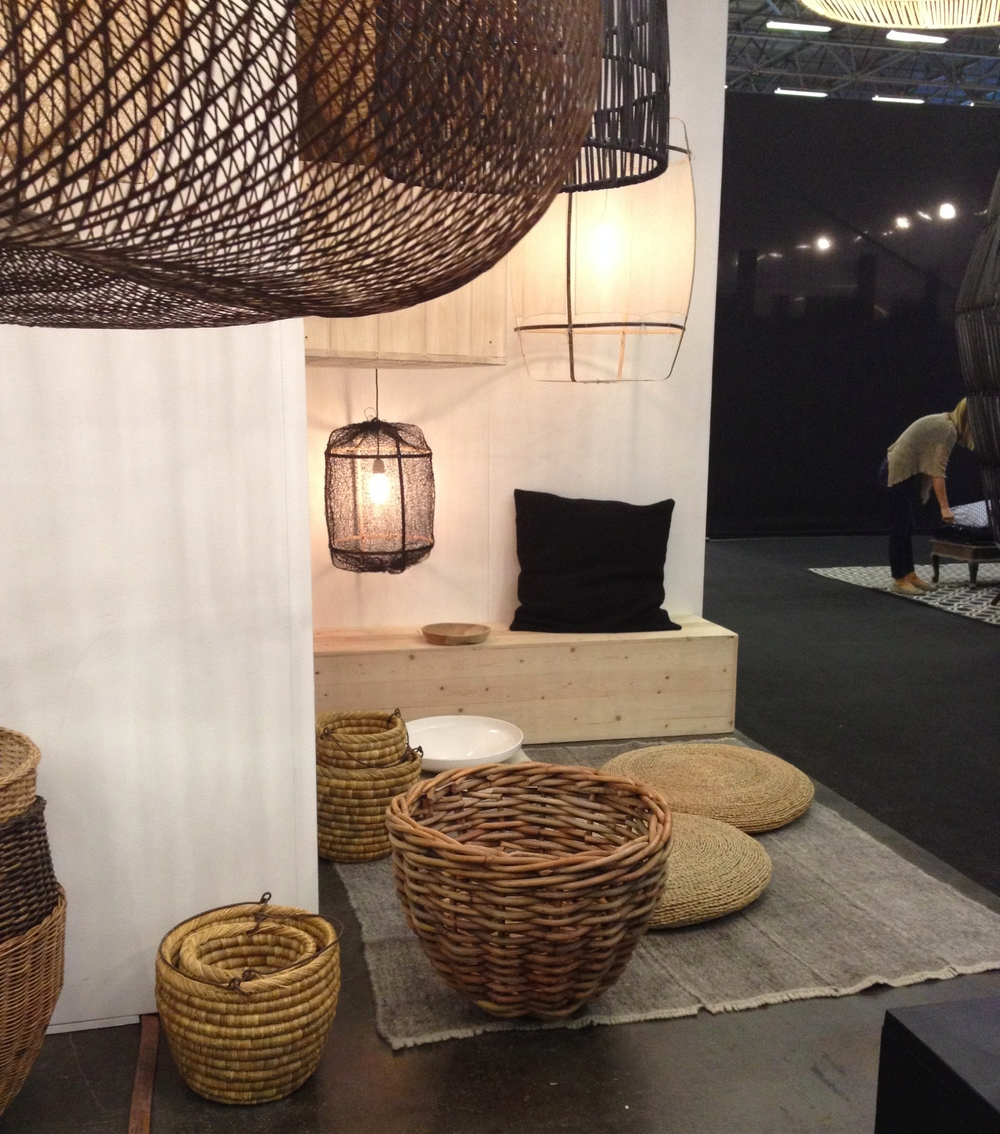 New plain grey radhi rug on the Ay Illuminate stand.  Just love those huge baskets by designer Nelson Sepulveda!
