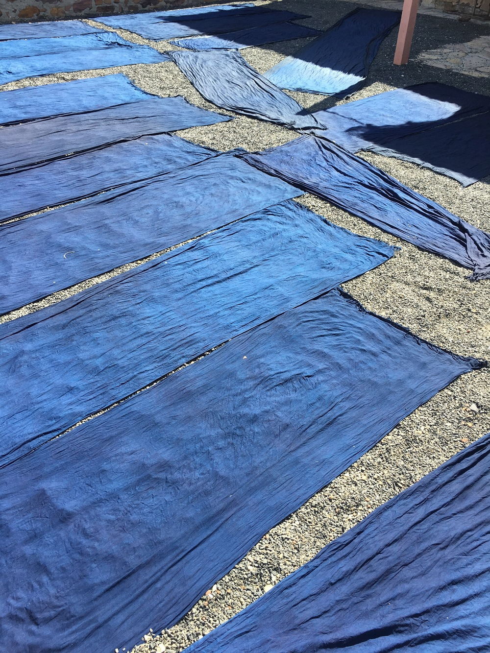 Naturally dyed indigo cloth drying in the sun