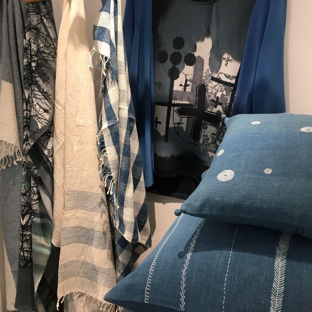 Stitch by Stitch cushions, towels and scarves with a Carole Waller scarf and shirt - prints inspired by Bath's roman archeology.