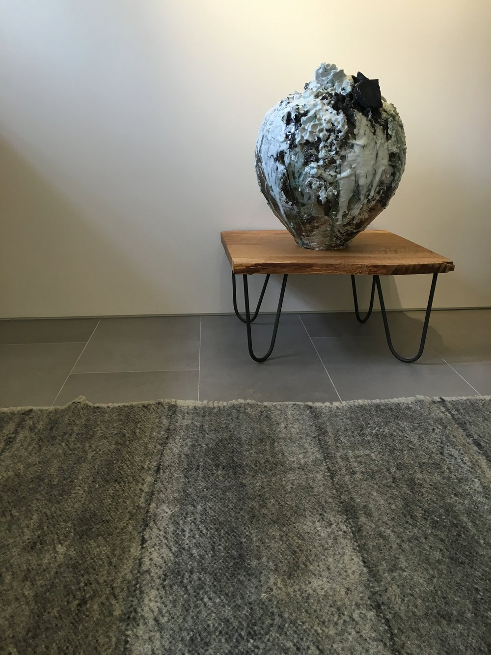 Akiko Hirai's Moonjar, displayed here with one of our radhi rugs at Flow Gallery last year.