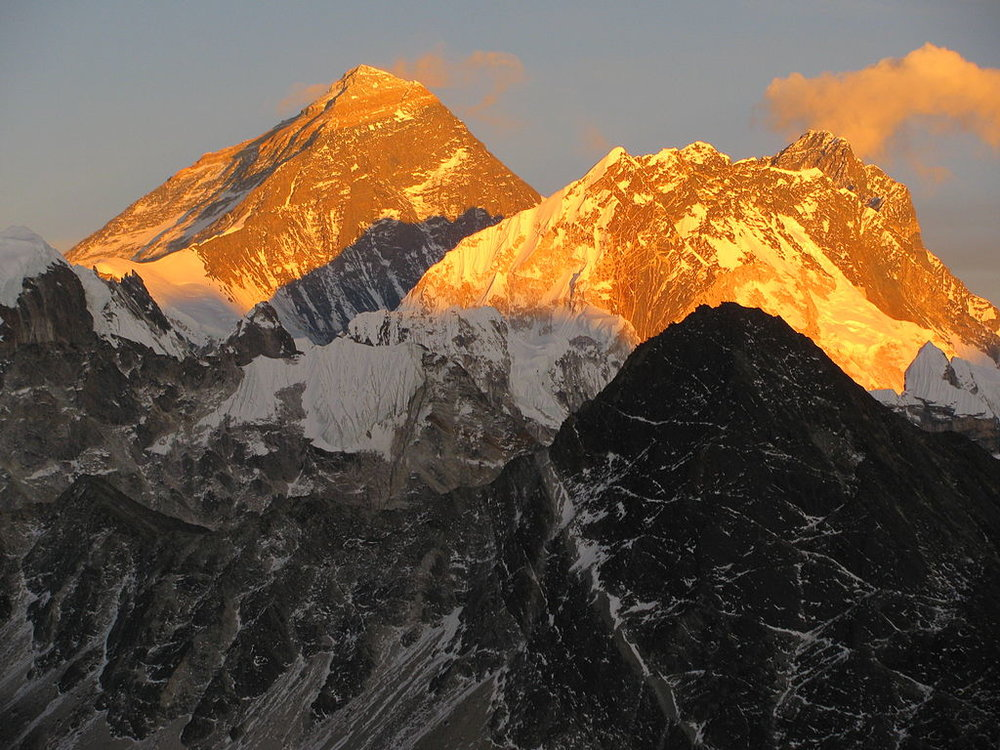 Glaciologist Kimberly Casey took this photo of Mt. Everest (left peak) lit by the sunset while she was in the field at Khumbu Glacier in the Nepali Himalayas. Shared through Creative Commons license.