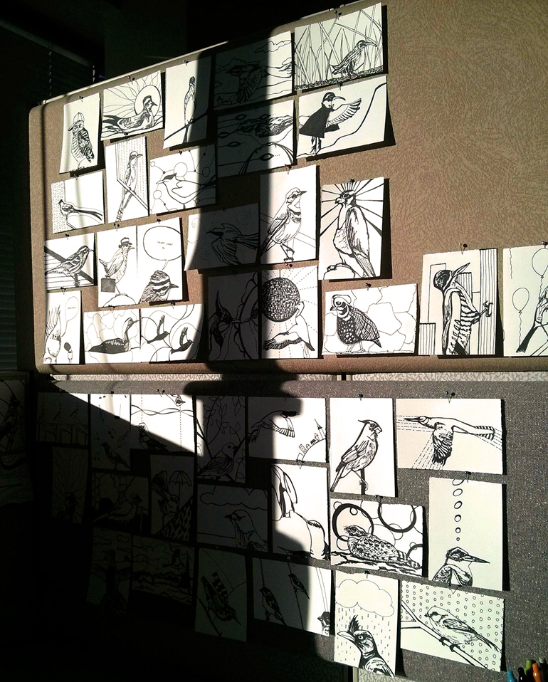 Birds on my cubicle wall in the late afternoon sun.