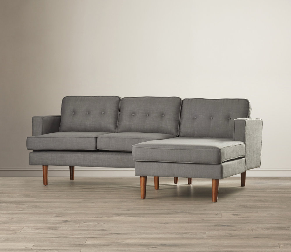 The Henley sofa offers a simple style and mid century vibe upholstered in grey linen fabric. Paired with a modern end table and a stylish coffee table, the entire set is $600.