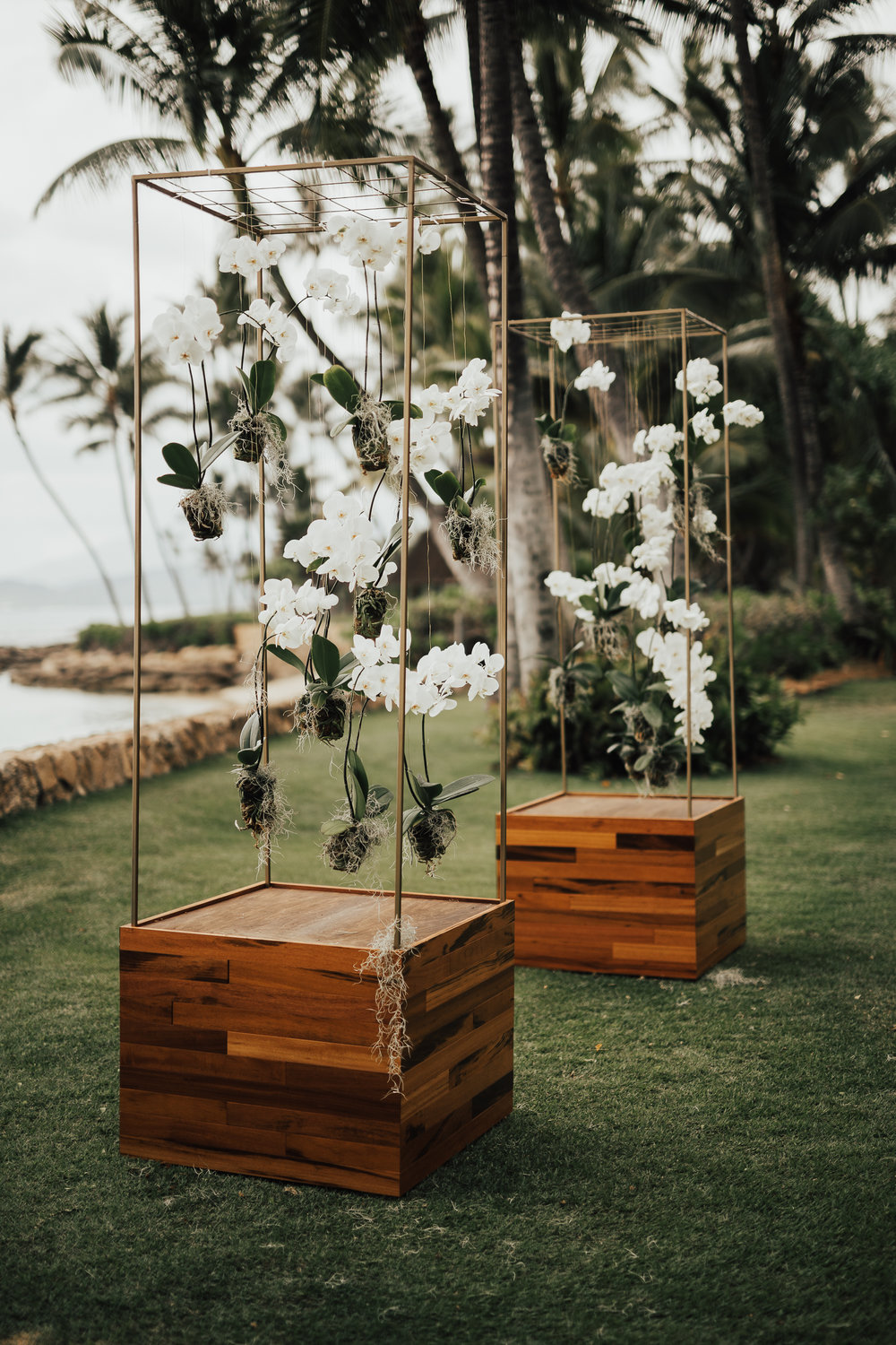Our modern towers can be reinvented in a myriad of ways—with hanging orchids, flower lei or a crystal chandelier. Perfect for a unique wedding ceremony or flanking a tent entrance. $500 for a set of 2 towers.