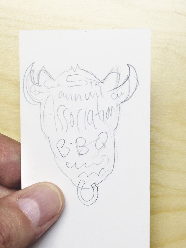 Original sketch on the back of a business card.