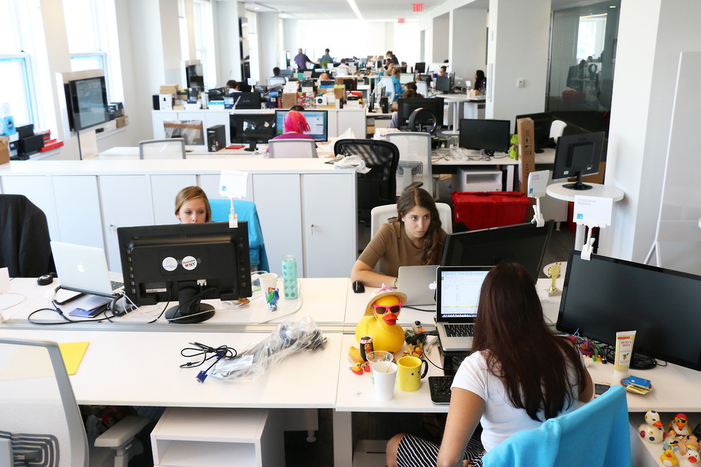 At the end of each desk cluster is a television. So while they work, the Mashable team can tune to cable channels and real-time site analytics reports.