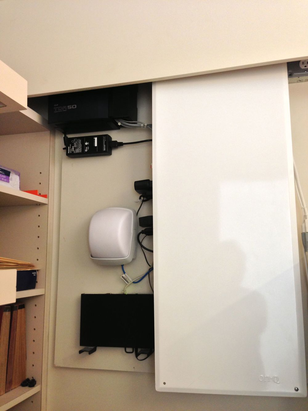 All the equipment is hidden in the mechanical closet, moving the electronics and their cords out of sight.
