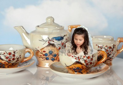 9600535-tea-party-with-antique-tea-cups-and-a-miniature-girl-like-in-alice-in-wonderland-jpeg