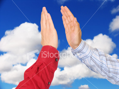 ist2_451212-business-men-giving-high-five-with-blue-sky-jpg