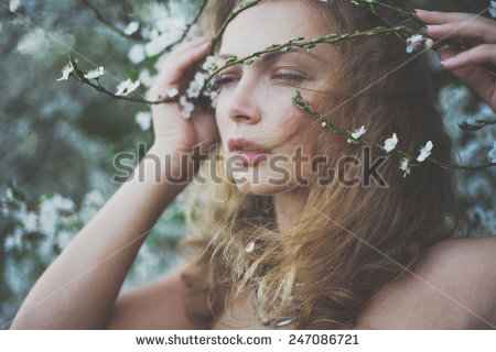 mysterious-beautiful-girl-with-flowers-in-her-hair-queen-blooming-gardens-fields-of-flowers-247086721.jpg