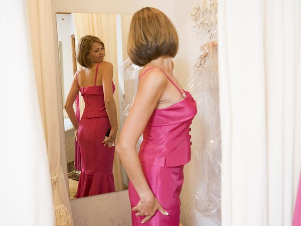 woman-trying-on-dress.jpg