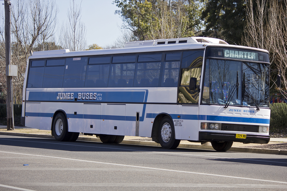 Junee_Buses_PMCA_'XL'_bodied_Hino_RG197K_parked_in_a_bus_stop_on_Morrow_Street_in_Wagga_Wagga.jpg