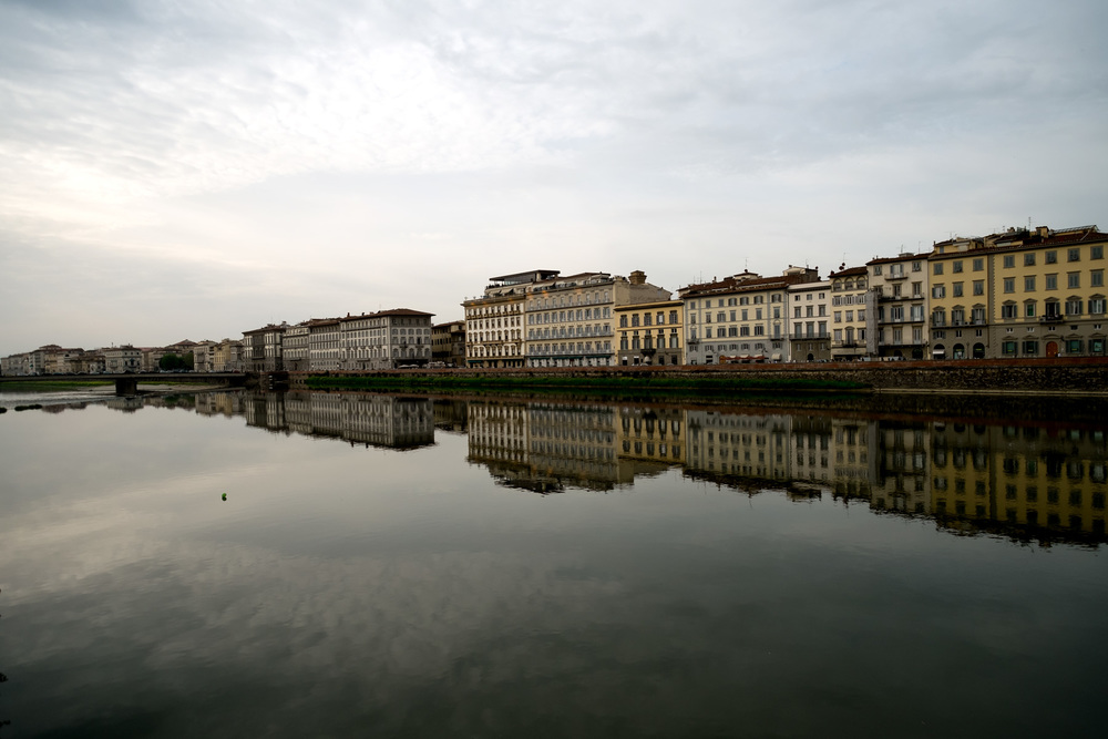 A view from the bridge along the picturesque Arno River.