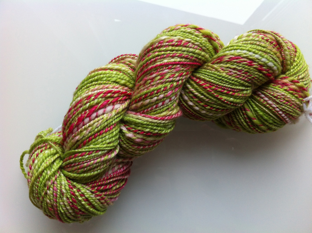 Two-ply handspun of the SweetGeorgia Yarns Panda fibre base in the Snapdragon colourway
