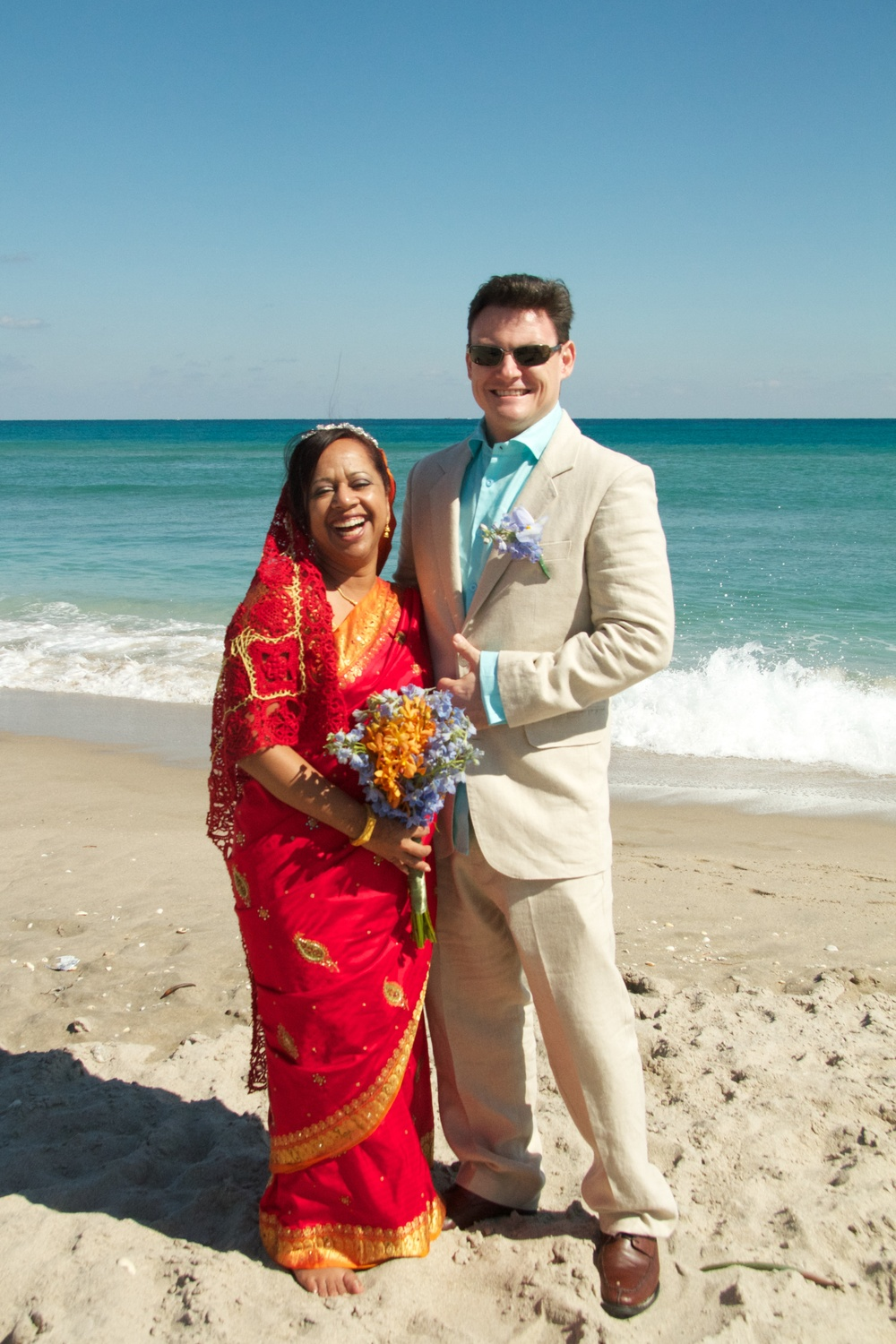 The newlyweds and their beach wedding.
