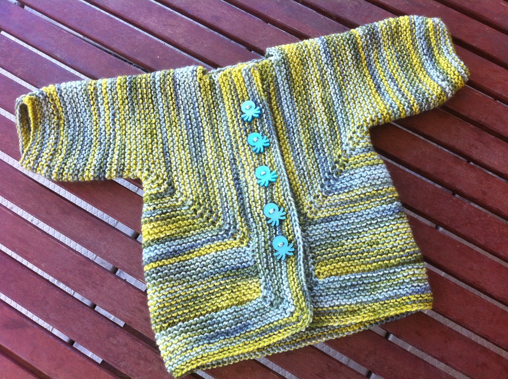 Pattern:  Baby Surprise Jacket  by Elizabeth Zimmermann Yarn:  Langstrath sock yarn by UK indie dyer Nimu  Yardage (for the Pre-Process Stashdown 2013): 400 yards (includes the booties - I had only a tiny nugget of yarn leftover)