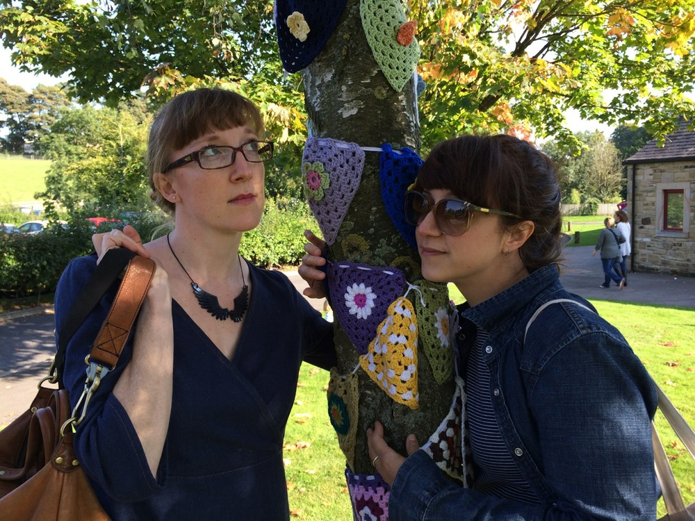 That's Renee on the left and Linda on the right - tree-hugging the yarn bomb bunting!