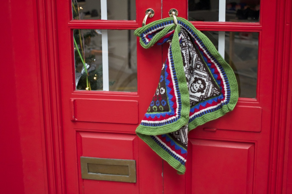 Couldn't resist using this festive red door as a backdrop for the blankie!