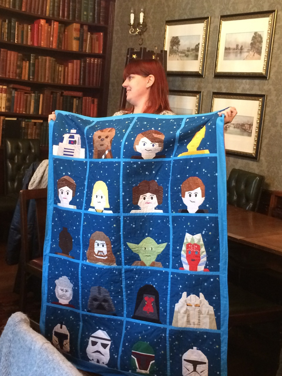 Apparently all of the faces are hand-pieced, and she made up two of them when unable to find a pattern. OMG! The backing ingeniously made use of a Lego Star Wars fleece blanket purchased from Legoland.