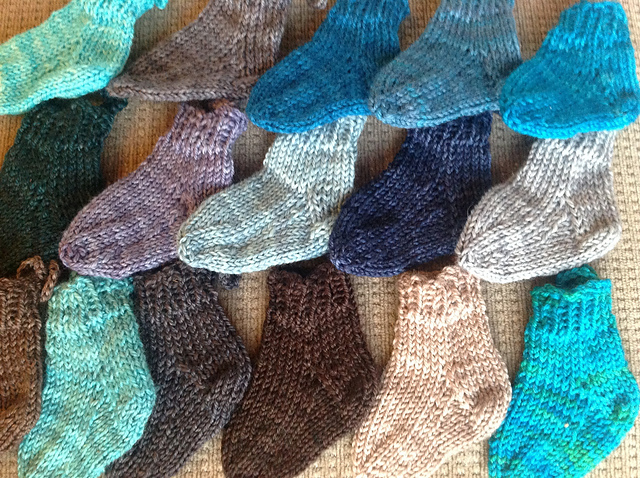 These are some of the mini socks that Catherine knit. Aren't they adorable? Such a perfect way to see the richness of the hand-dyed yarn. Photo courtesy of Catherine Hopkins.