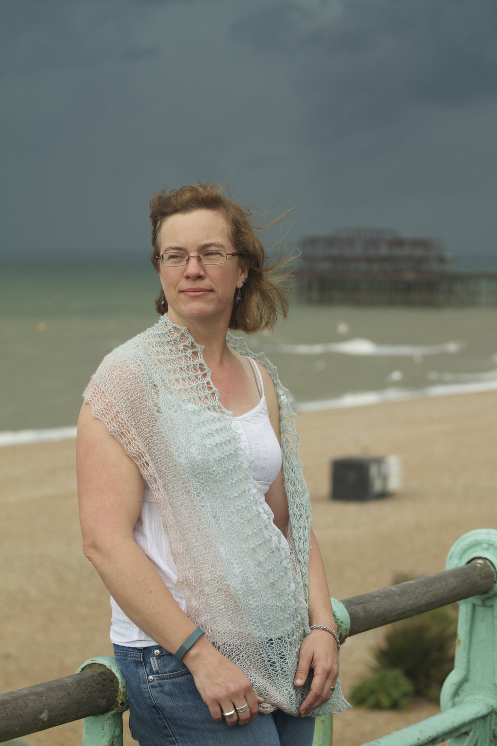 The longer version of the cowl was knit in two colours using a slipped stitch in the transition portion to work the two colours. We chose a stitch that mimics water rushing over the rocky beach in Brighton.