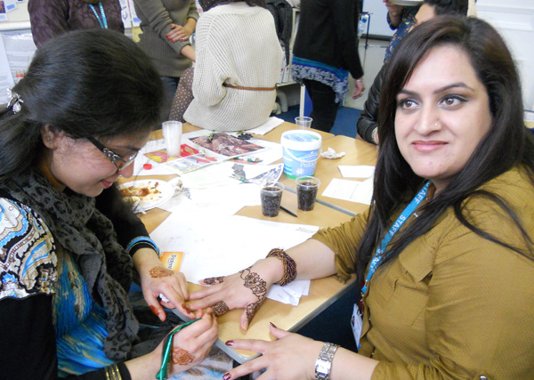 Students at Walsall Adult and Community College raising money  for the Trust through henna hand painting.