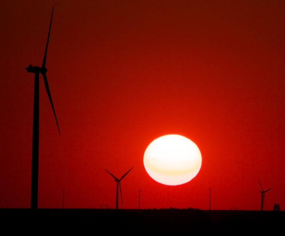 2012-07-09 at 18-38-49 windmill sunset red sun energy renewable prairie.jpg