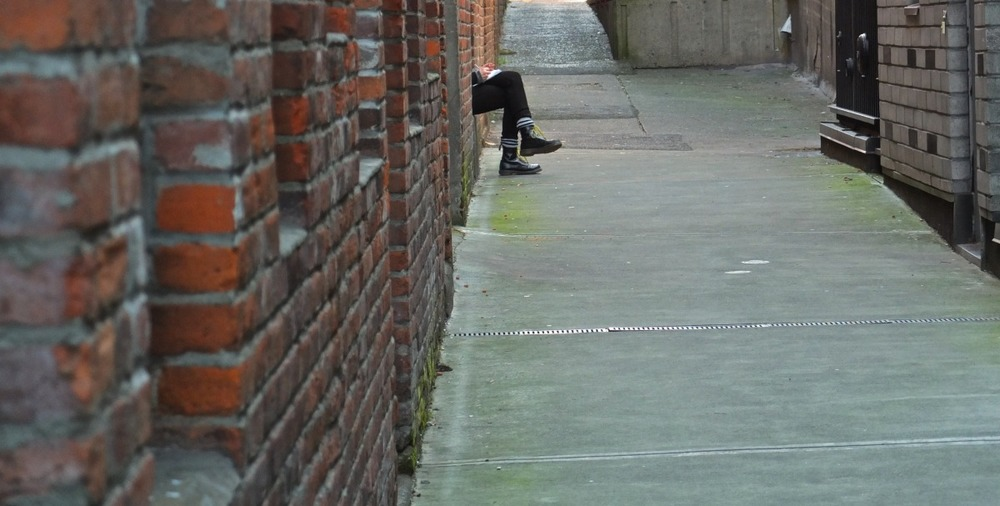 2012-02-04 at 14-31-14 alley bricks city feet legs narrow urban victoria writing.jpg