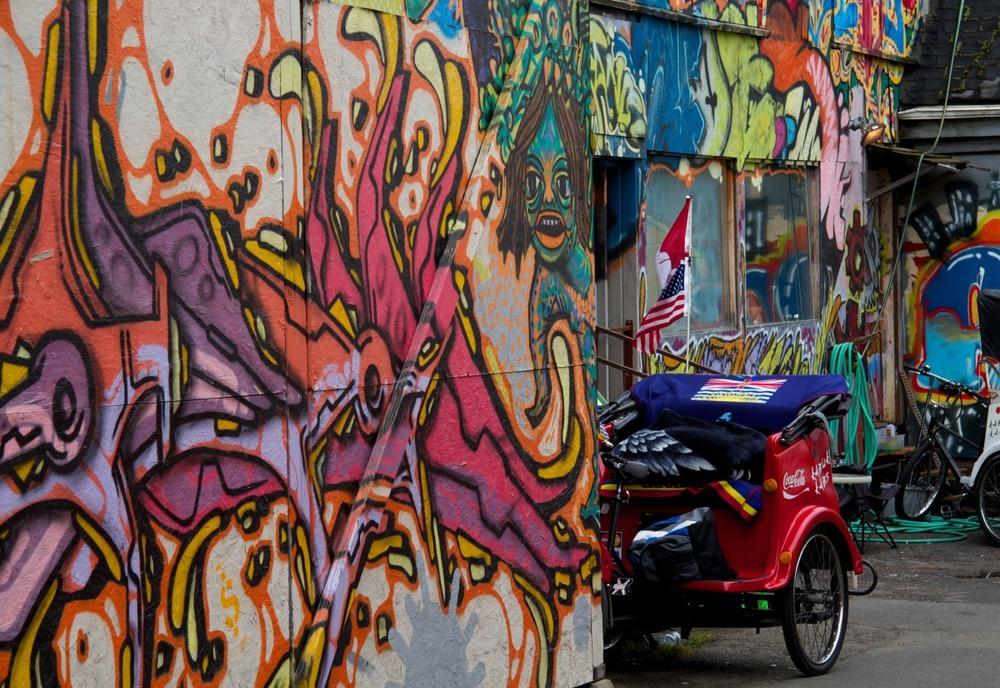 2010-05-29 at 13-26-22 grafitti pedicab urban city rickshaw stairs wall.jpg
